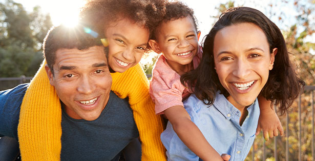 image of happy family in the sunlight